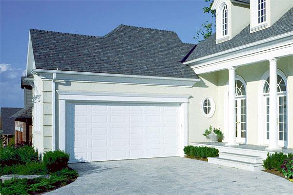 quel type de porte de garage choisir et pourquoi gazette du net. Black Bedroom Furniture Sets. Home Design Ideas